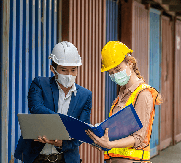 Two workers wearing masks during COVID-19
