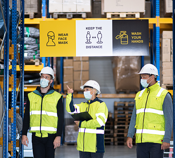 Warehouse workers wearing masks during COVID-19